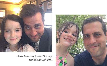 Attorney Aaron Hartley and his daughters.